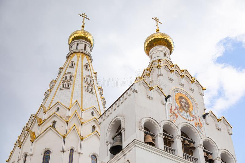 Bottom view of white christian church with bell-tower with image of Jesus Christ stock photo