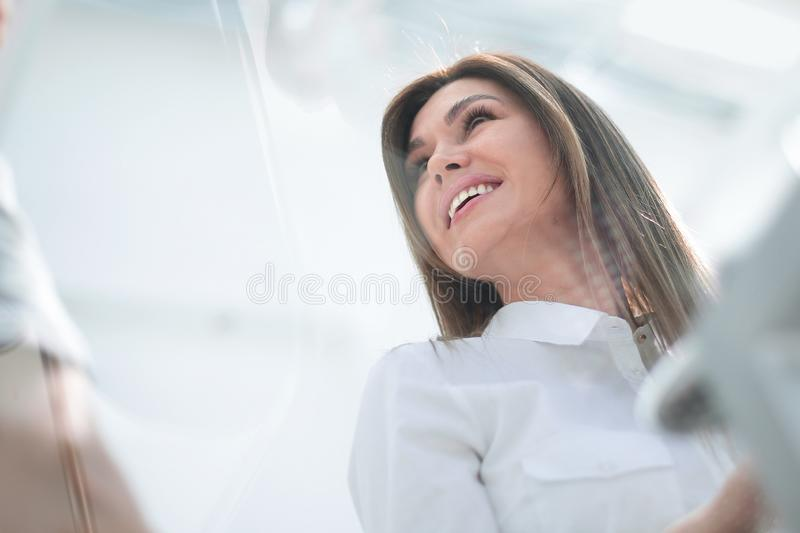 Bottom view.young business woman in the workplace stock image