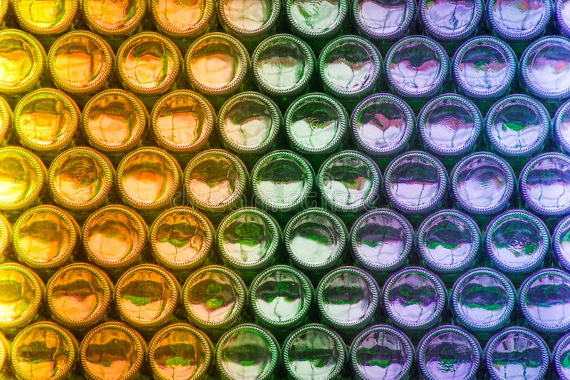 Bottoms of symmetrically stacked beer bottles stock photography