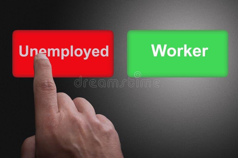 Bottoni con i disoccupati ed il lavoratore ed il dito scritti indicare, su un fondo grigio di pendenza fotografie stock