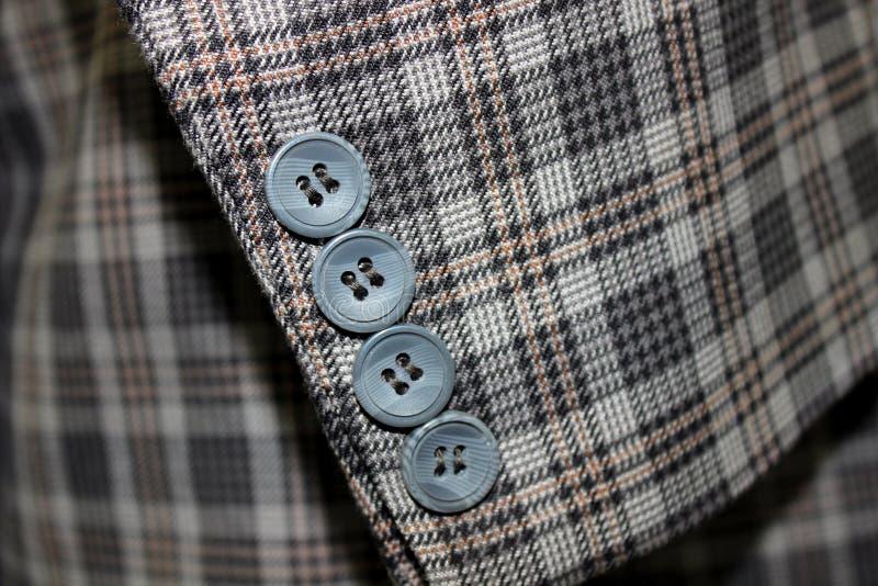 Bottoni in un vestito fotografie stock libere da diritti