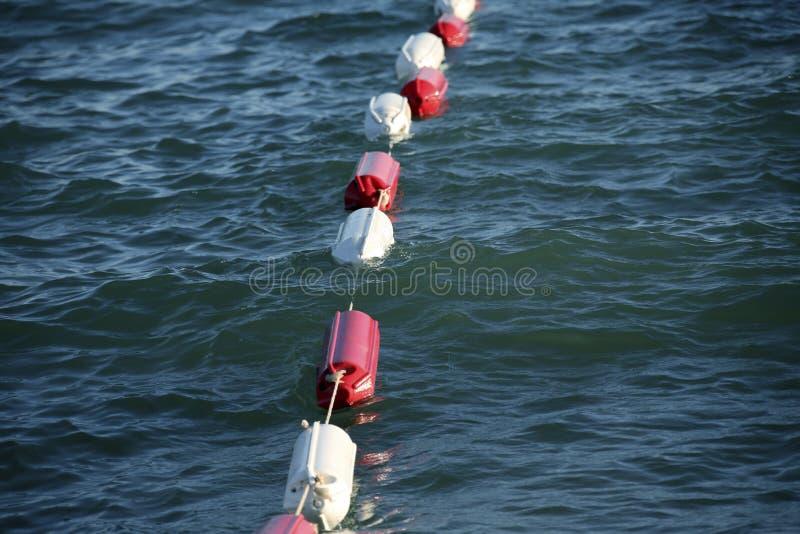 Bouées sur l'eau photographie stock libre de droits