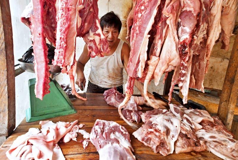 Bouchère de personne d'origine chinoise, Gorontalo, Indonésie photo libre de droits