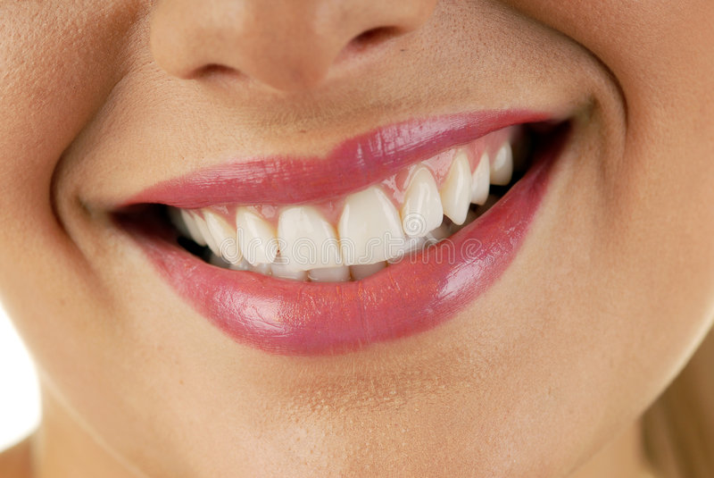 Bouche de sourire de femme image stock