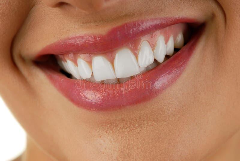 Bouche de sourire de femme photographie stock libre de droits