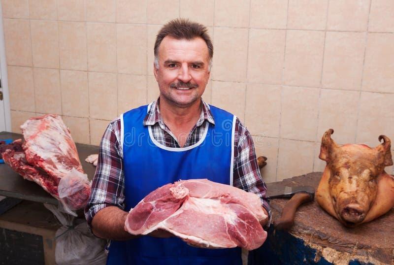 Boucher et viande mûrs photos stock