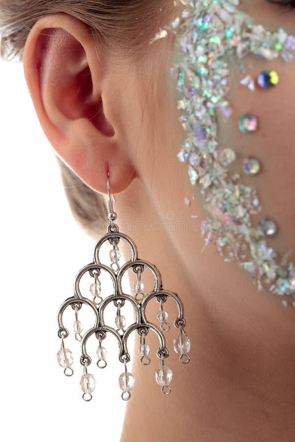 Boucle d'oreille argentée image stock
