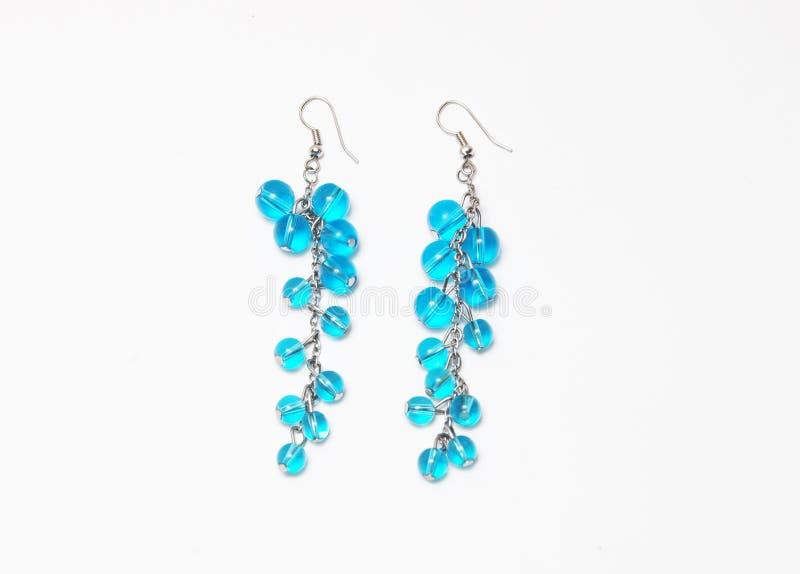 Boucle d'oreille bleue photos stock