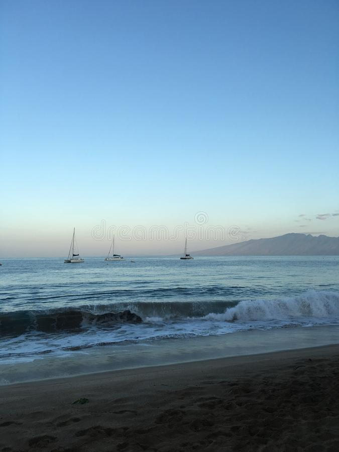 Boucle de observation réglée de vague du soleil d'Hawaï dessus à la plage photos libres de droits