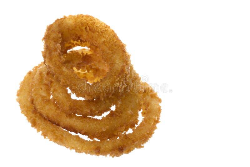 Boucles d'oignon frites d'isolement images libres de droits