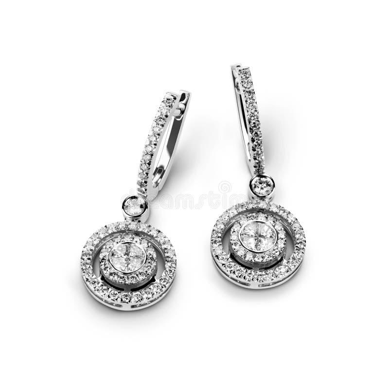 Boucles d'oreille d'or blanc avec les diamants blancs images stock