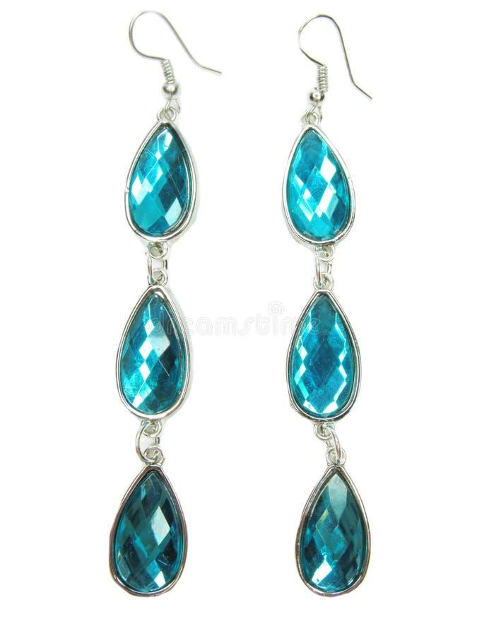 Boucles d'oreille de bijou avec les cristaux bleus photos stock
