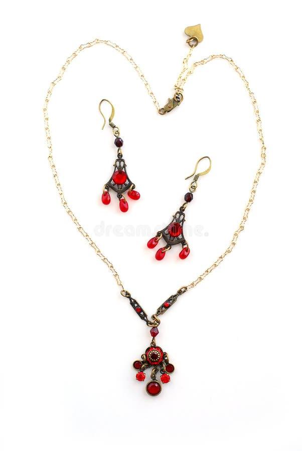 Boucles d'oreille de collier de bijou photo libre de droits