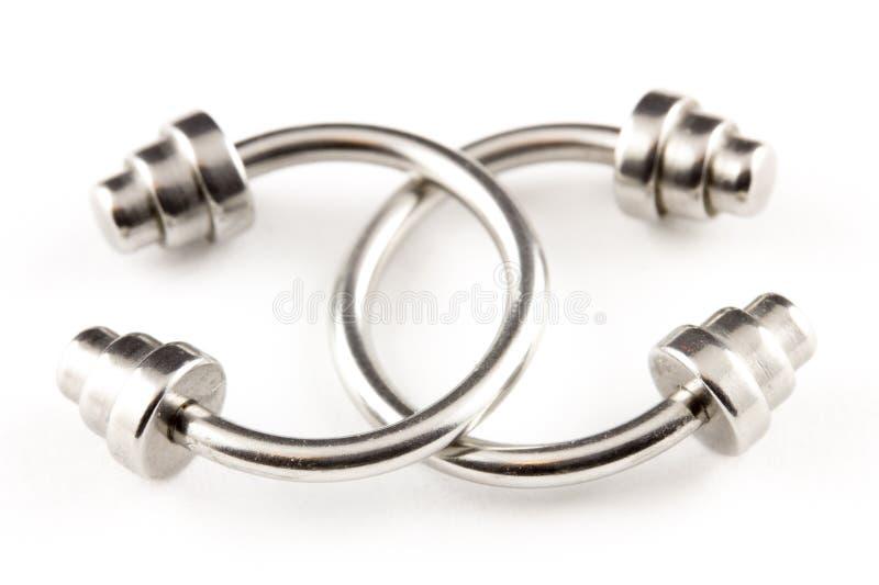 Boucles d'oreille Piercing images libres de droits