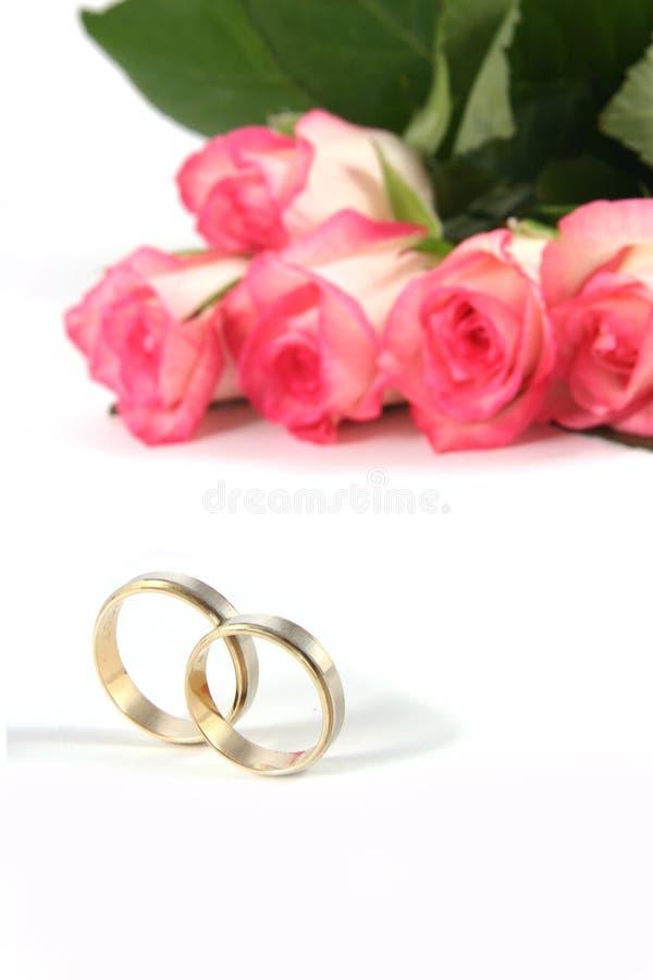 Boucles et roses de mariage images libres de droits