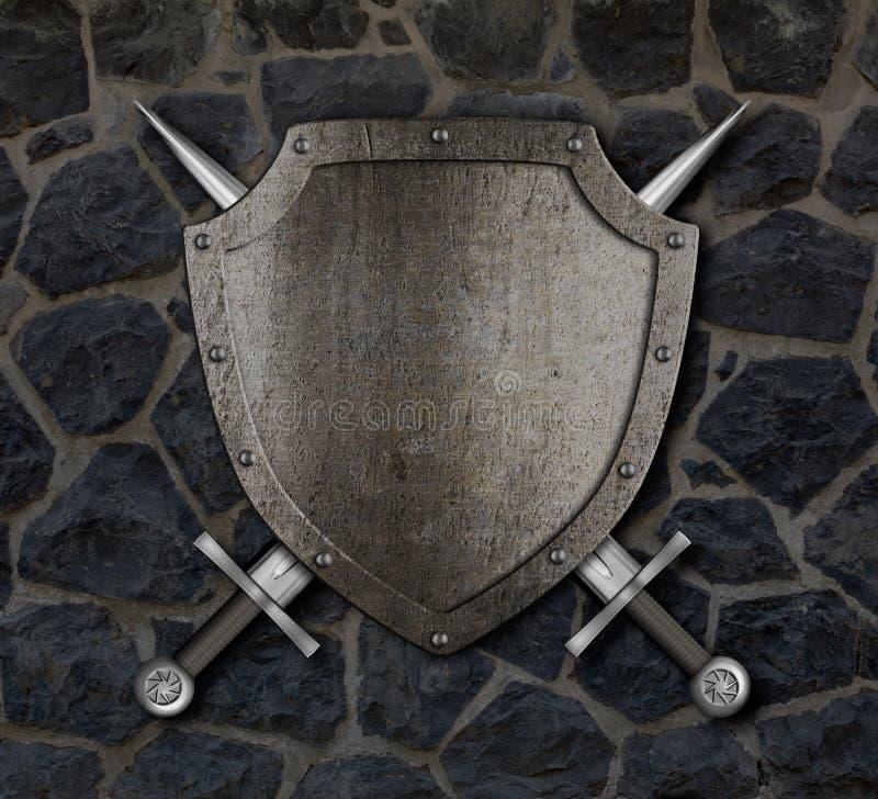 Bouclier médiéval et épées croisées sur le mur photo stock