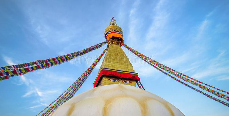 Boudhanath stupa, eyes, prayer flags, blue sky, Kathmandu, Nepal. Top of Boudhanath stupa, eyes watching, prayer flags, , blue sky, Kathmandu, Nepal royalty free stock image