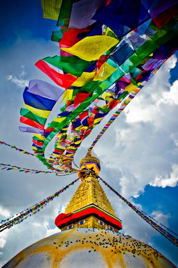 Boudhanath Stupa with prayer flages in the wind and deep blue skies, Kathmandu, Nepa stock image