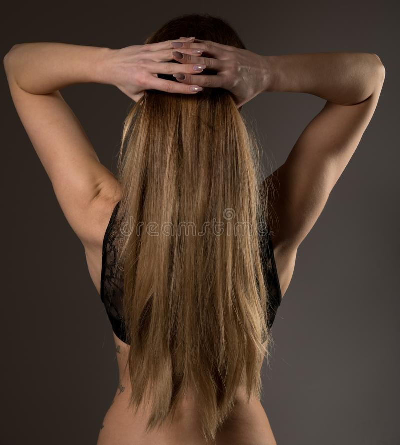 Boudoir photography of a beautiful young woman over dark background stock images