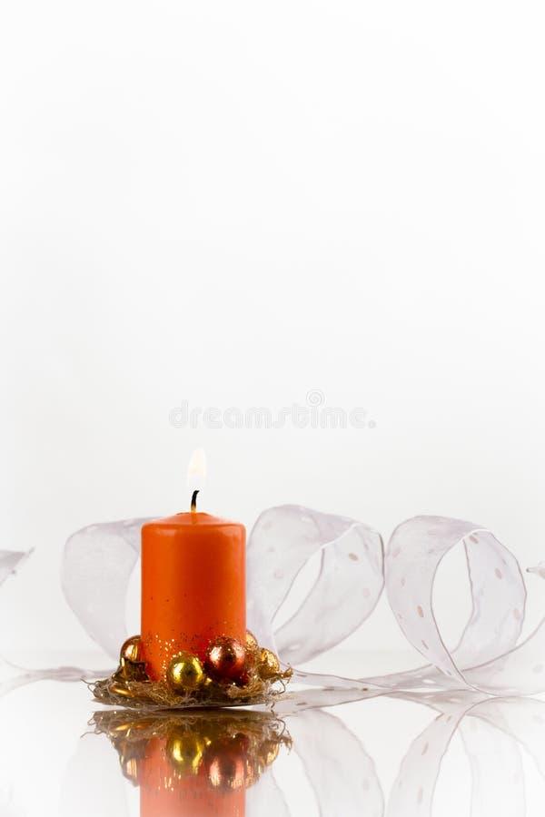 Bougie orange et bande blanche images stock