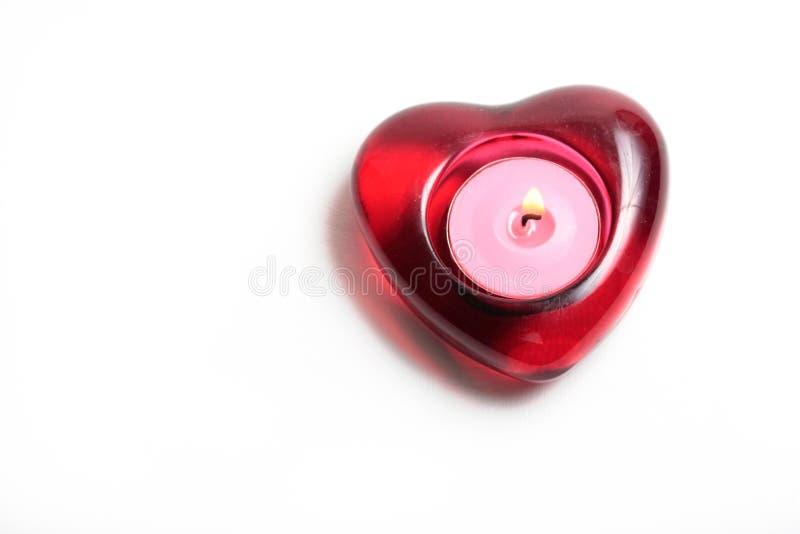 Bougie rouge de coeur avec la flamme image libre de droits