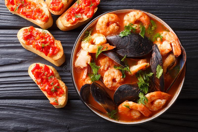 Bouillabaisse soup with seafood and fish close-up in a bowl serv stock photography