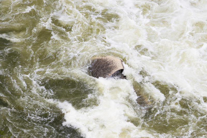 A boulder being eroded by strong currents. From a dam release in central Texas in 2007 royalty free stock image