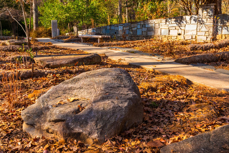 Boulder and footpath in Stone Mountain Park, USA royalty free stock photography