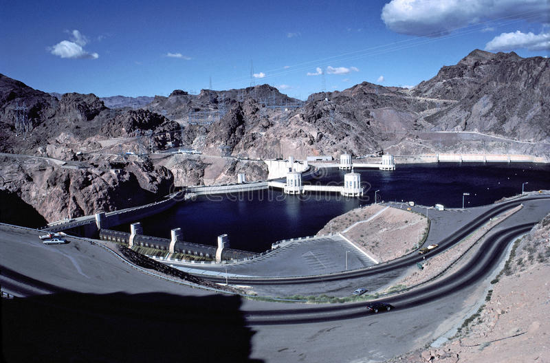 Boulder or Hoover Dam with water at highest level. Image shows the Boulder or Hoover Dam with water at highest level behind dam. Note the over flow at left side stock image