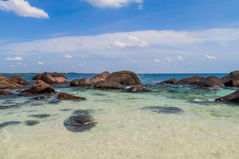Boulders around the coast of Pigeon Island near Nilaveli village in Sri Lan. Ka stock image