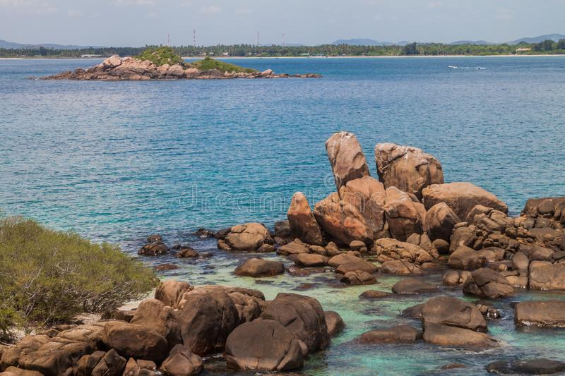 Boulders around the coast of Pigeon Island near Nilaveli village in Sri Lan. Ka royalty free stock photo