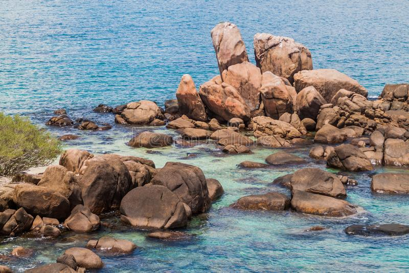 Boulders around the coast of Pigeon Island near Nilaveli village in Sri Lan. Ka stock photography