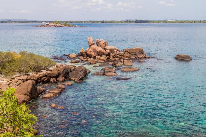 Boulders around the coast of Pigeon Island near Nilaveli village in Sri Lan. Ka royalty free stock photography