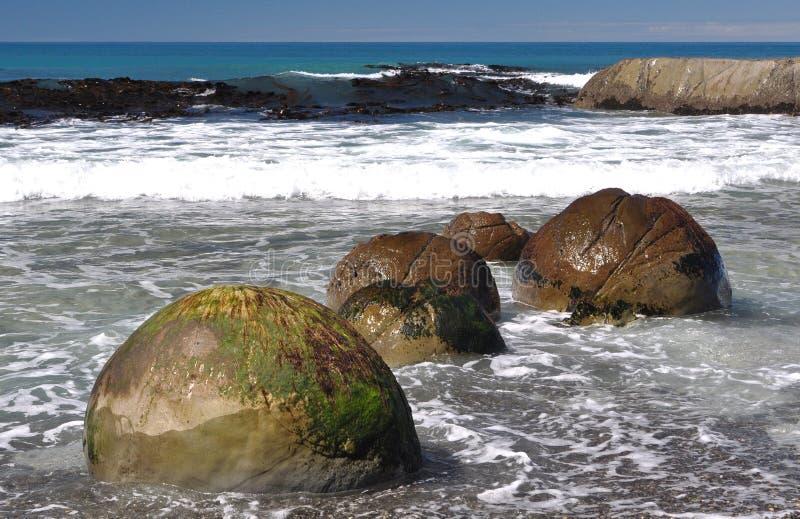 Boulders at remote Ward Beach royalty free stock photography