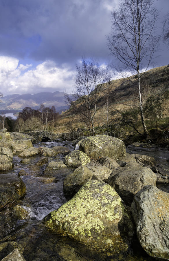 Boulders in River, Lake District, England stock photos