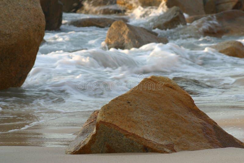 Boulders at sea stock image