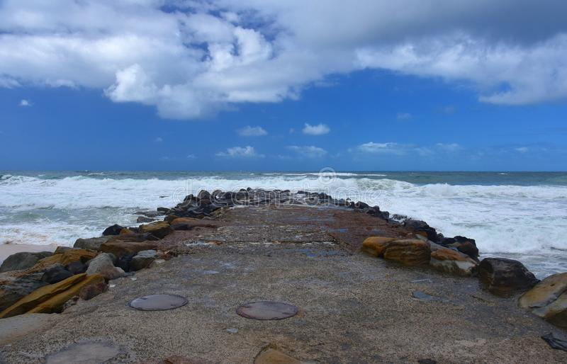 Boulders serve as a breakwall to protect Kings beach. Caloundra, Sunshine Coast, Queensland, Australia. Wall structure designed to protect coastal land from the royalty free stock images