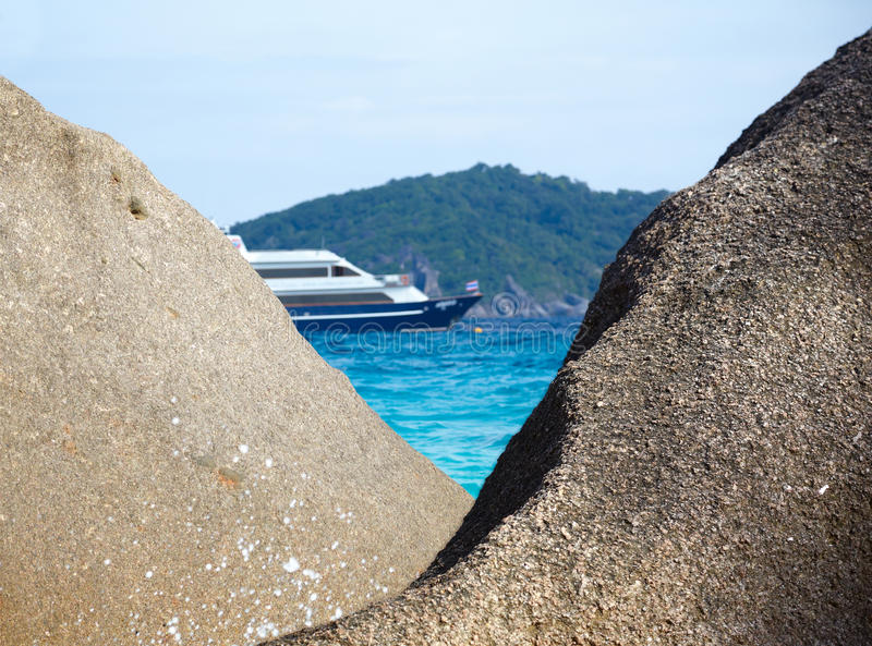 Boulders ship and ocean royalty free stock photos