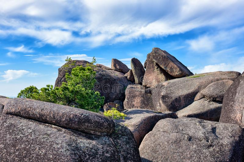 Boulders on top of cliff. Stolby Nature Sanctuary Pillars. Krasnoyarsk region. Russia stock image