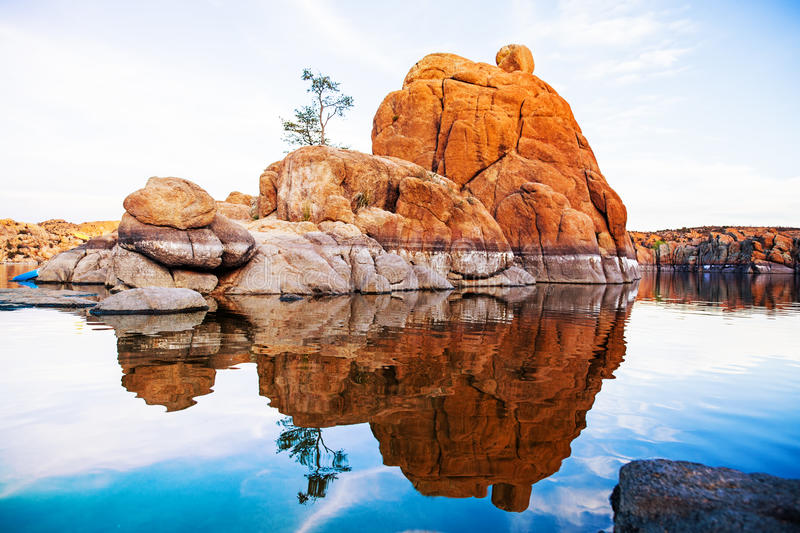 Boulders With Tree in Watson Lake - Arizona. Large red rock formation with one tree in the middle of Watson Lake in Prescott, AZ, USA stock images