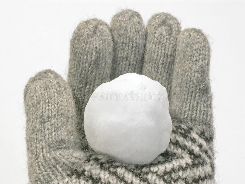 Boule de neige en gant de l'hiver images stock