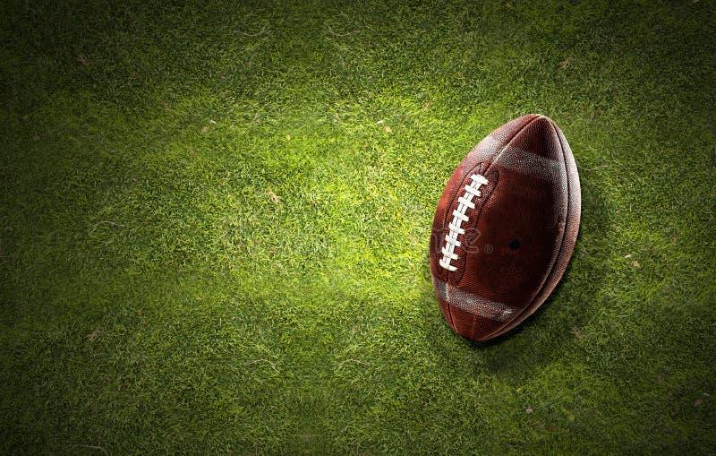 Boule de rugby sur l'herbe photographie stock
