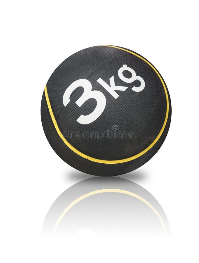 Boule en caoutchouc de sport noir avec la ligne jaune et le texte blanc, 3kg, dessus photo stock