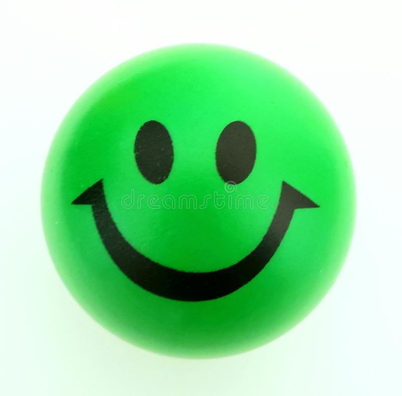 Boule souriante d'effort de visage photo stock