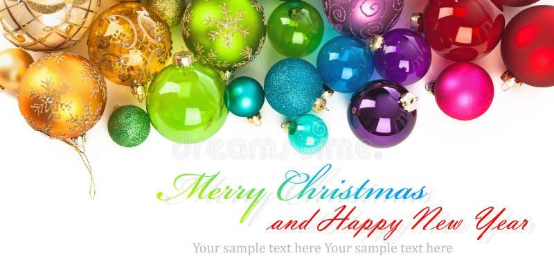 Boules colorées par Noël photographie stock libre de droits