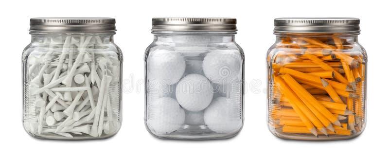 Boules de golf, pièces en t, et crayons image libre de droits