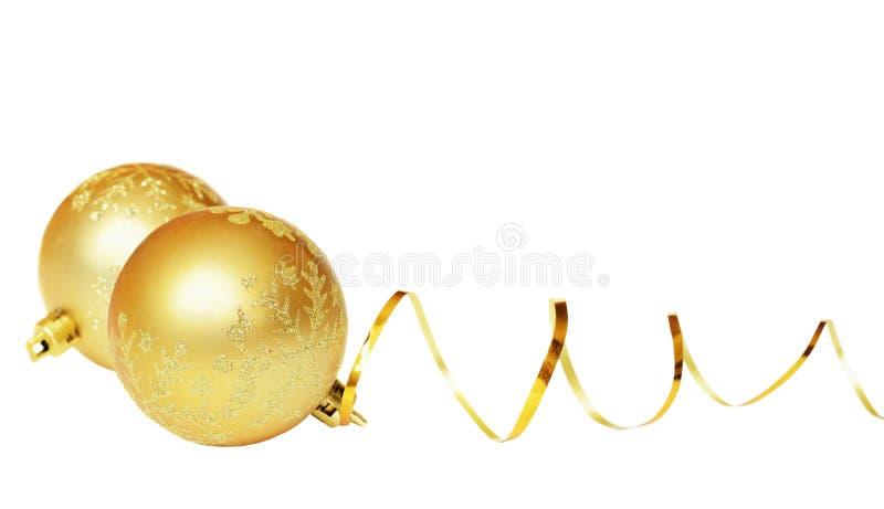 Boules jaunes et ruban d'or photographie stock