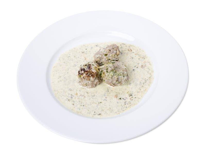 Boulettes de viande en sauce blanche photos stock