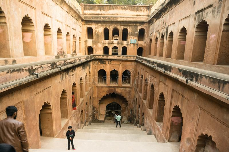 The bouli or stepwell at the bara imambara lucknow. Lucknow, India - 3rd feb 2018: The bouli or stepwell at teh bara imambara complex. The stone steps surrounded stock images