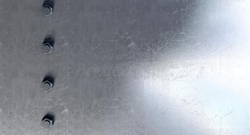 Boulons sur une surface métallique images libres de droits